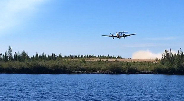 Plane taking off from Misaw Lake Lodge runway